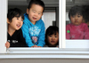 Tsunami_survivors_children_ofunato_